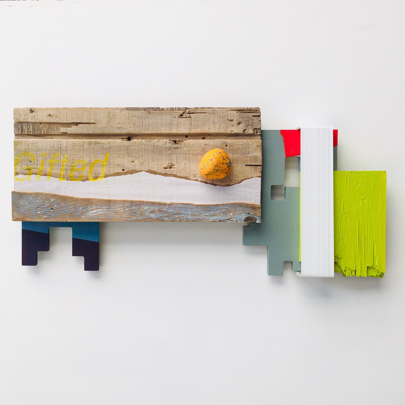Andrés Ferrandis Gifted, 2020 Acrylic on wood, polyester, objet trouvé, a painted stone and aluminum 14 x 29 x 2.3