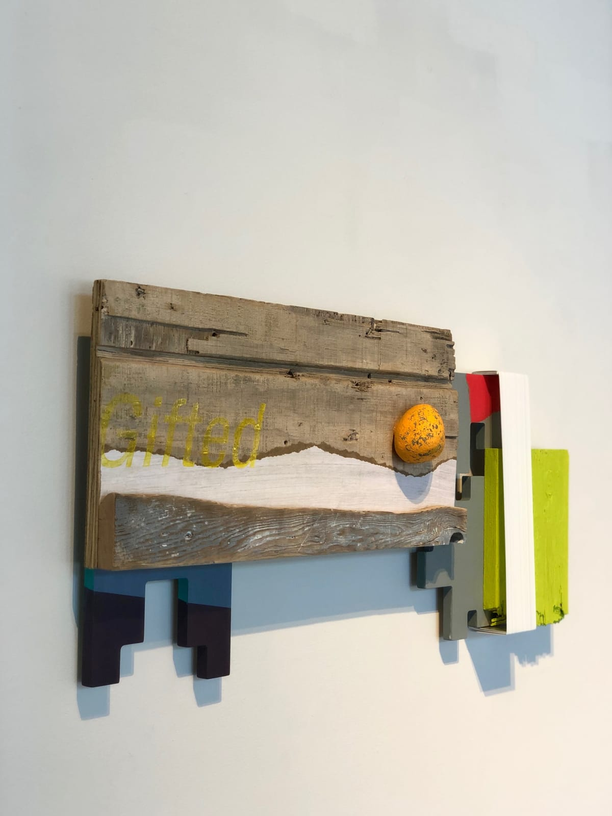 Andrés Ferrandis Gifted, 2020 Acrylic on wood, polyester, objet trouvé, a painted stone and aluminum 14 x 29 x 2.25