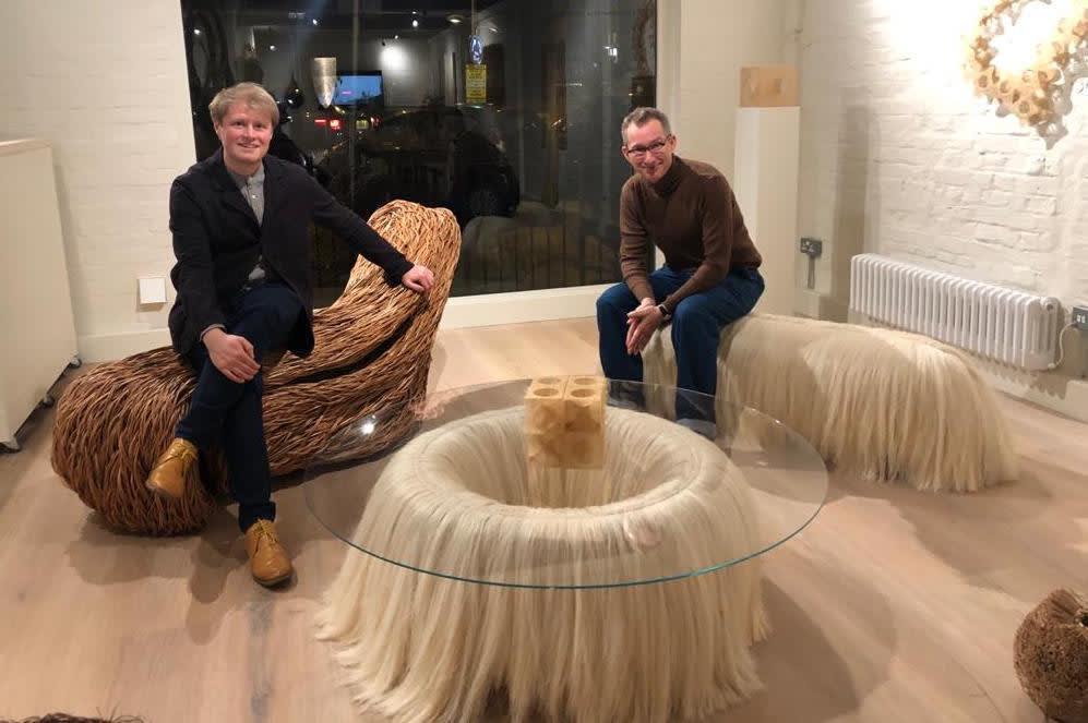 Artist Sebastian Cox sat on Laura's bench, with journalist Grant Gibson