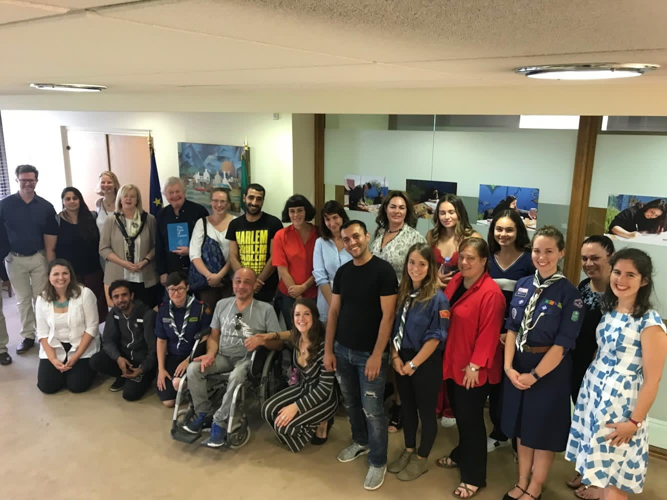 Sculptor John Behan (sixth from left, standing) with refugees, NGO workers and diplomats at the Irish Embassy, Athens this week.