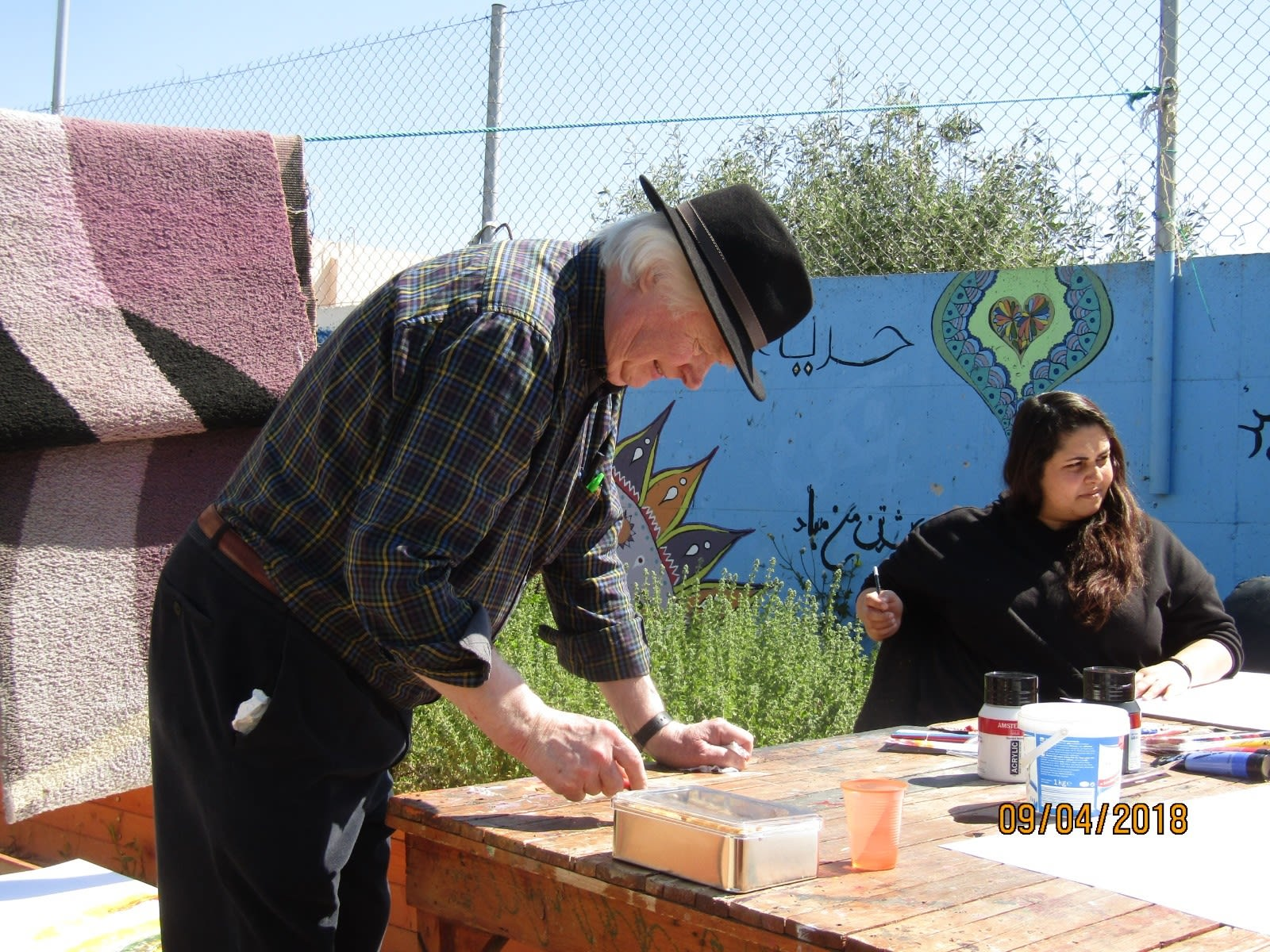 John Behan working with refugees at Eleonas camp in Athens during an earlier visit this year.