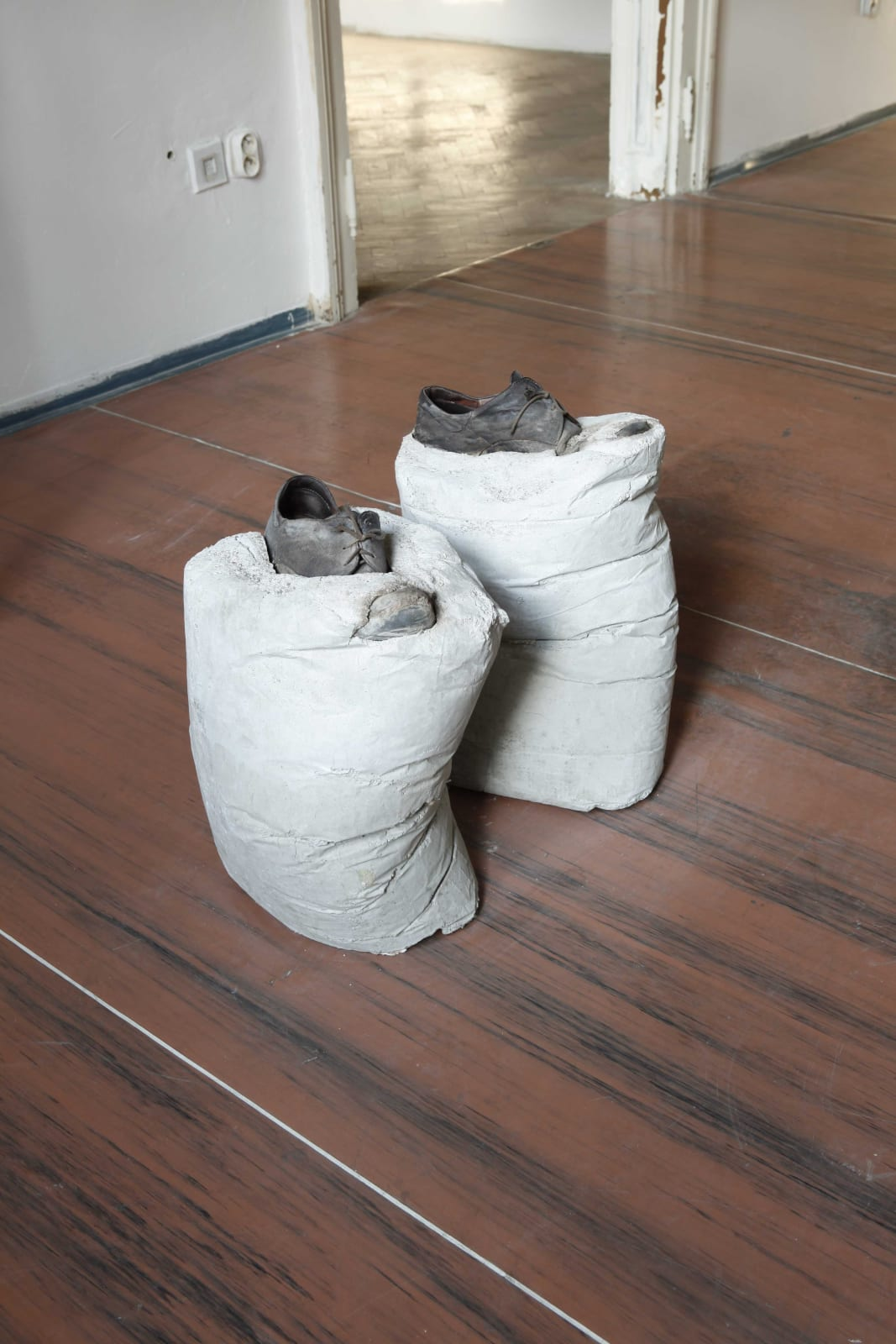 Kristof Kintera, Me, waiting in another room, 2009, shoes, concrete, 65 x 40 x 55 cm