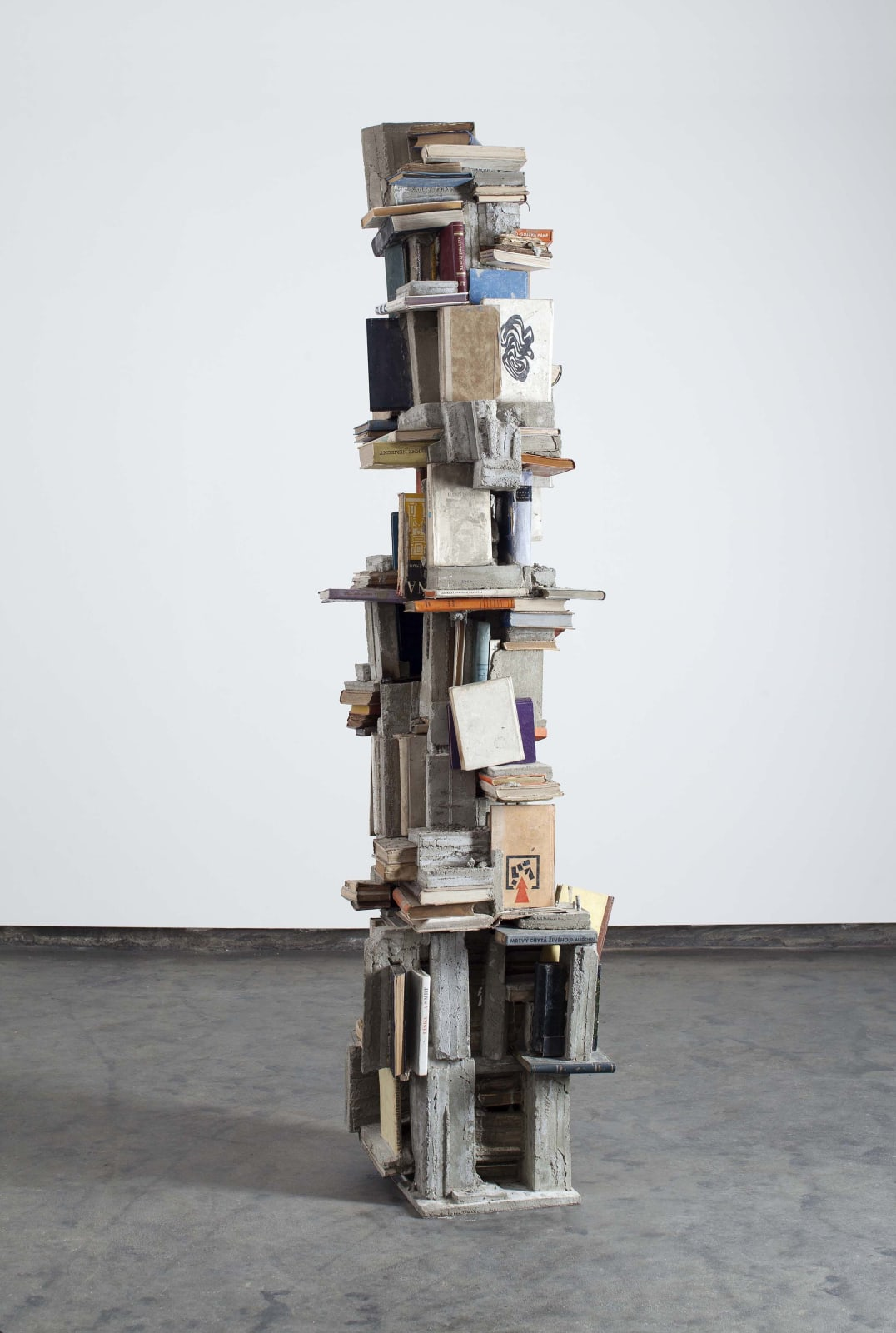 Kristof Kintera,The end of words, 2014, concrete, books cm 230 x 40 x 50
