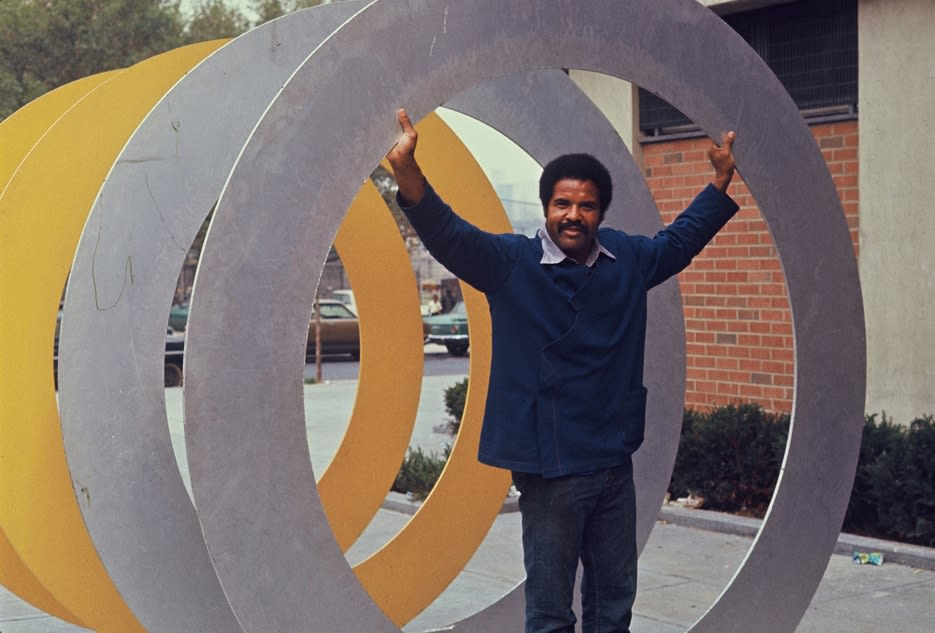 """<div class=""""additional_caption"""">Melvin Edwards with 'Double Circles', 1970. Bethune Tower, 650 Malcolm X Boulevard, Harlem, New York.</div>"""