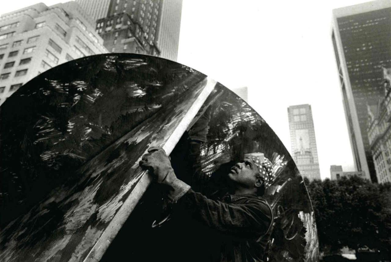 "<div class=""additional_caption"">Melvin Edwards installing 'Tomorrow's Wind', 1991. Doris C. Freedman Plaza, New York</div>"