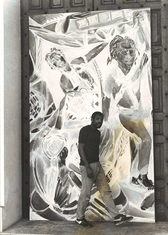 <p><span>Portrait of Denzil Forrester standing in front of 'Wolf Singer' (1984).</span></p>