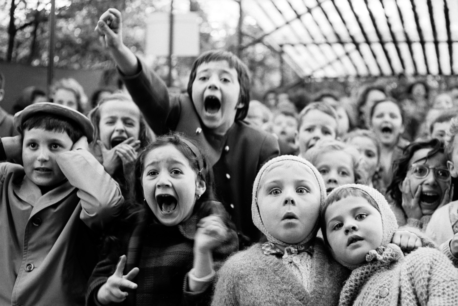 Alfred Eisenstaedt, Puppet Show, Tuileries, Paris (the moment a dragon is slain), 1963