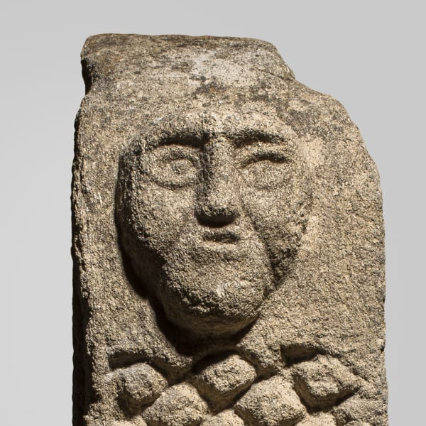 """<span class=""""title""""><em>Stone corbel carved with a mask and scrolling vine motifs</em>, 12th century</span>"""