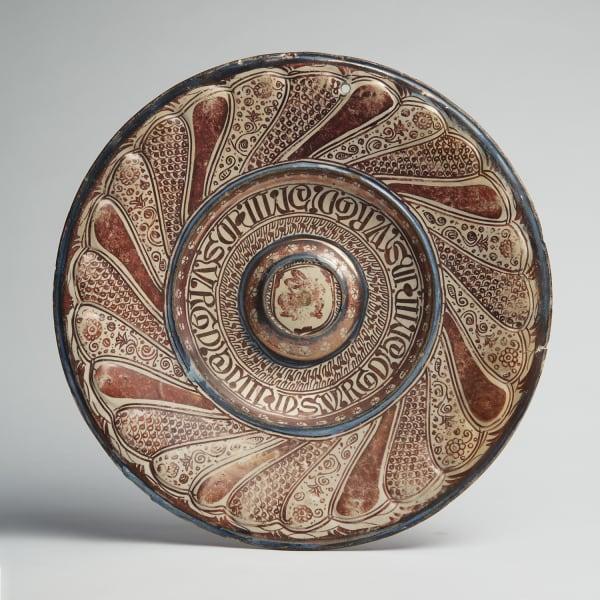 "<span class=""title""><em>A Hispano-Moresque gadroon-moulded lustreware charger</em>, c. 1500-20</span>"
