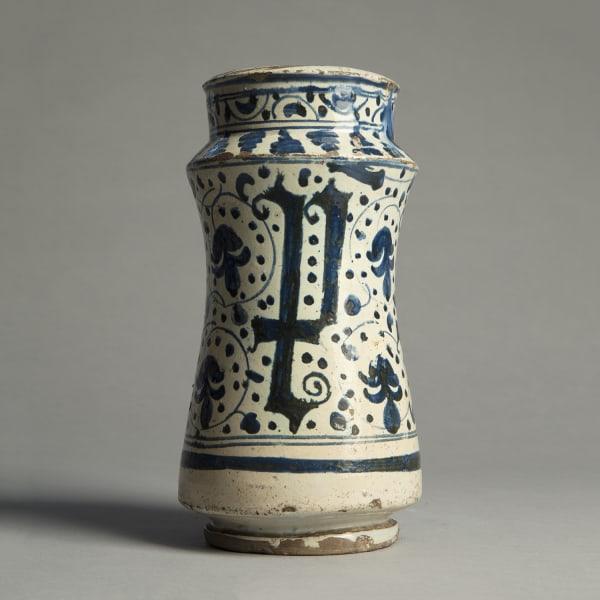 "<span class=""title""><em>A stout Hispano-Moresque albarello decorated with cobalt foliage and letter forms</em>, c. 1400 - 50</span>"