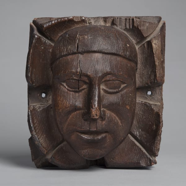 """<span class=""""title""""><em>A carved oak boss with the head of a man amongst foliage</em>, second half of the 15th century</span>"""