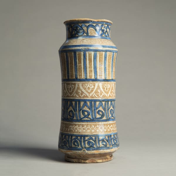 """<span class=""""title""""><em>A slender albarello decorated with pseudo-Kufic motifs and palmette designs</em>, c. 1400 - 30</span>"""