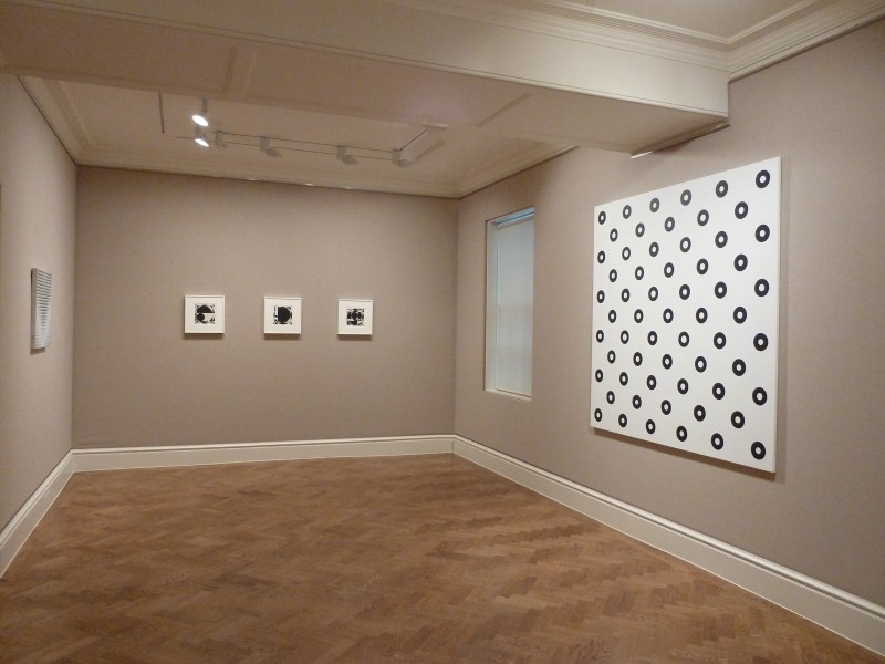 Far wall: Untitled (1960), Untitled (1960) and Untitled (1960), right: Dilated Centres (1963)