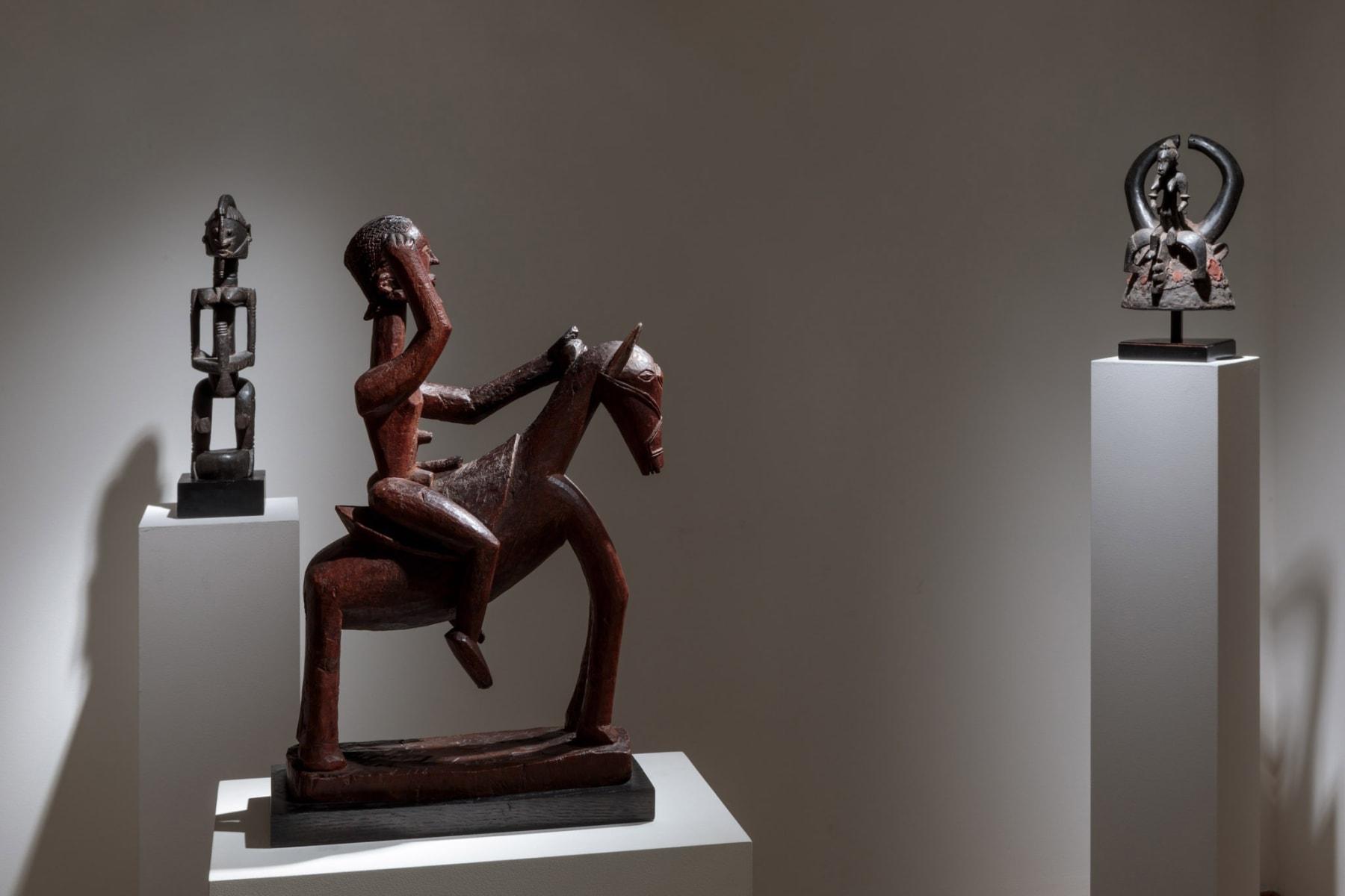 Dogon Figure; Dogon Horse and Rider, both from Mali; Senufo Helmet, Ivory Coast