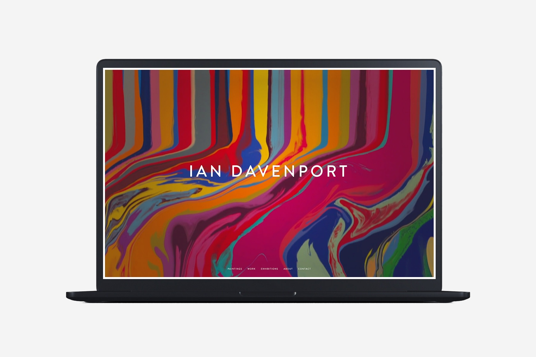 Laptop with example page of Ian Davenport website