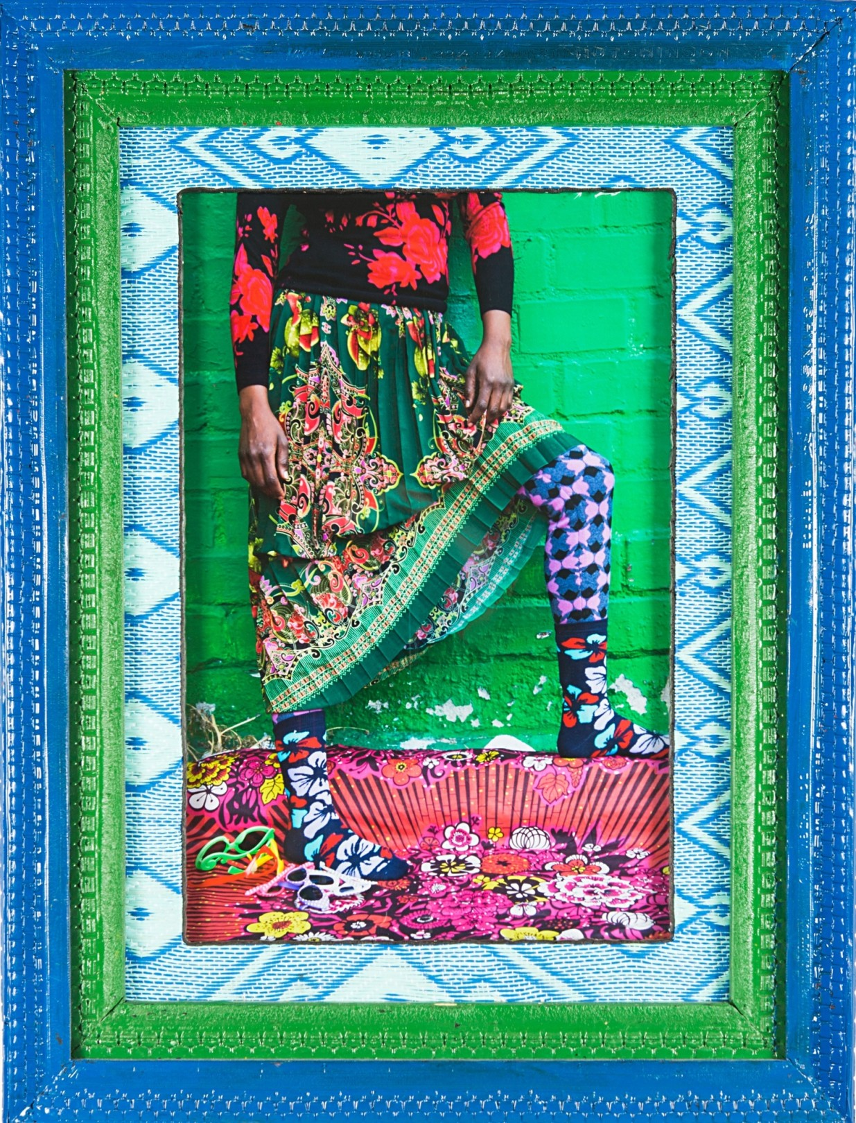 Hassan Hajjaj Wamuhu Legs, 2014/1435 Print: Metallic Lambda Print on 3mm Dibond Frame: Wood, tyre, plastic mat & perspex Frame: 41.34h x 31.5w in (105h x 80w cm) Print: 29.53h x 19.69w in (75h x 50w cm) edition of 5 plus 2 artist's proofs