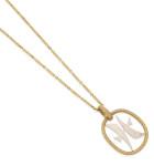 A gold pendant by Patek Phillipe