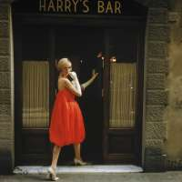 """A model wearing a Fabiani """"Bag"""" dress is photographed outside Harry's Bar in Florence, Italy in Via del Parione"""