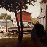 Brown truck, red barn