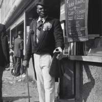 Barker with Megaphone Outside Food Stand, New York City