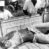 Prison Series (Prisoner Lying In Back of Truck)