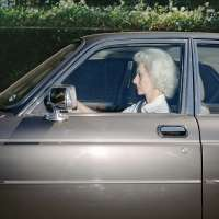 Woman caught in traffic while heading southwest on U.S. Route 101 near the Topanga Canyon Boulevard exit, Woodland Hills, California, at 5:38 p.m. in the summer of 1989