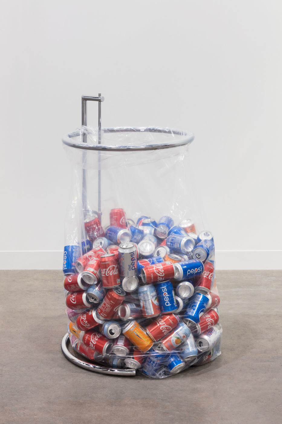 "<div class=""title""><em>Recycling Sculpture (Eileen Gray Table)</em>, 2018</div><div class=""medium"">reproduction Eileen Gray E-1027 Table, plastic recycling bag, replenished recyclables</div><div class=""dimensions"">dimensions variable</div>"