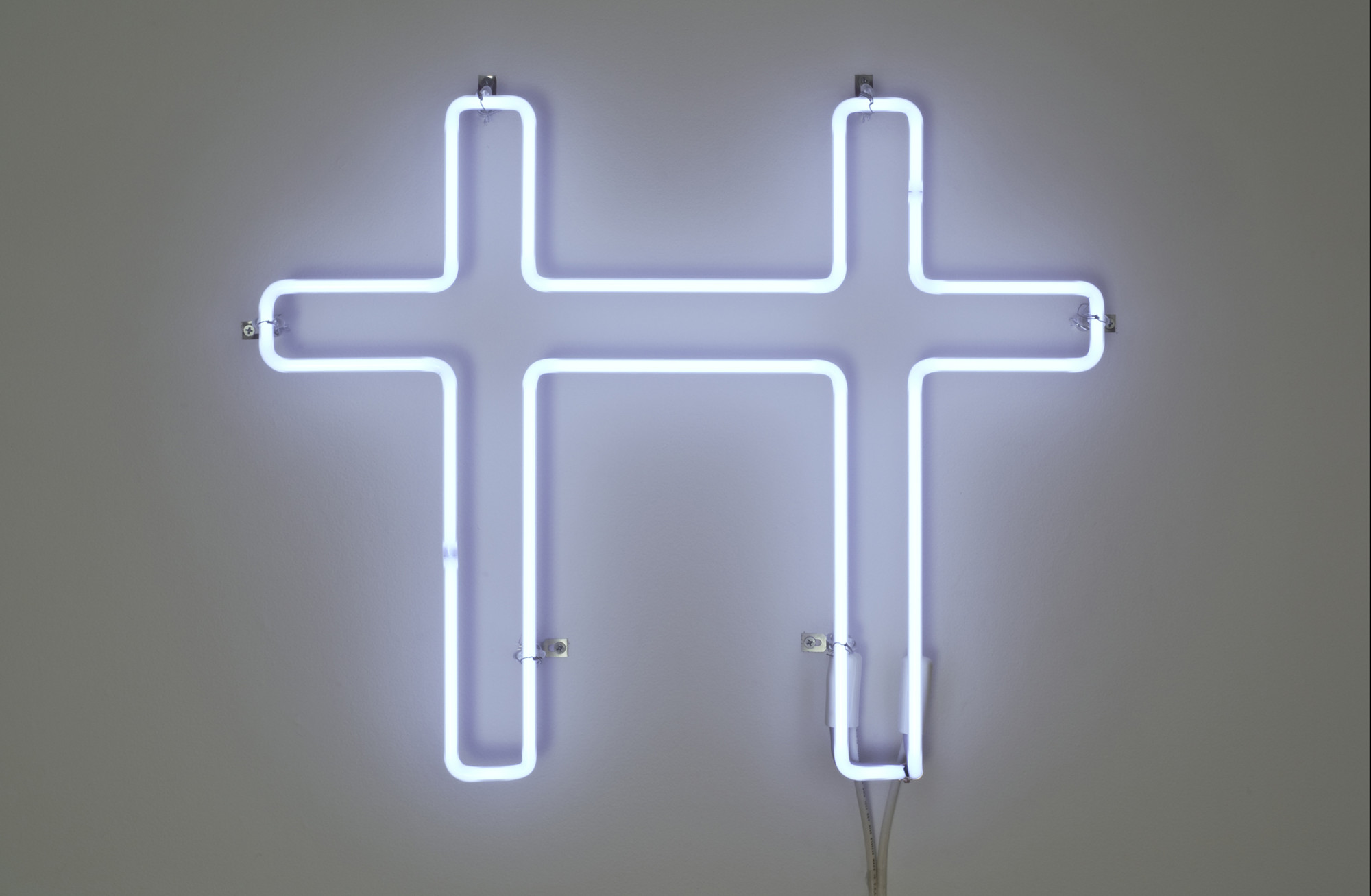 "<div class=""title""><em>Neon Cross for Two</em>, 2007</div><div class=""medium"">white neon</div><div class=""dimensions"">45.72 x 58.42 x 5.4 cm<br />18 x 23 x 2 1/8 in.</div>"