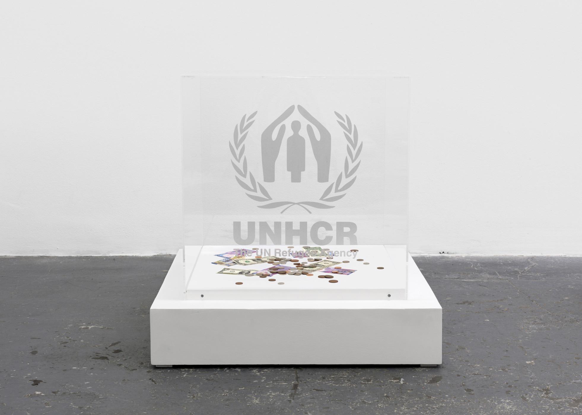"<div class=""title""><em>Contribution Cube (UNHCR)</em>, 2004/2016</div><div class=""medium"">plexiglass vitrine, vinyl sticker, wood base</div><div class=""dimensions"">79.0 x 76.0 x 76.0 cm<br />31 1/16 x 29 7/8 x 29 7/8 in.</div>"