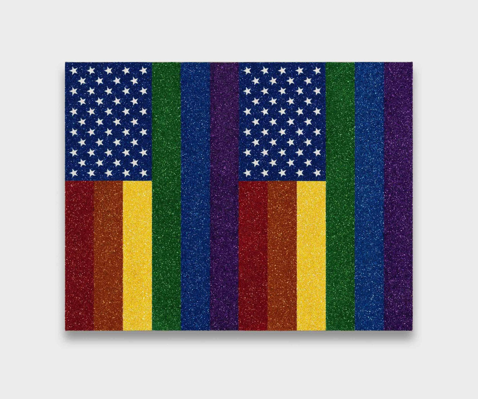 "<div class=""title""><em>Two Rainbow American Flags for Jasper in the Style of the Artist's Boyfriend</em>, 2017</div><div class=""medium"">glitter and enamel on linen</div><div class=""dimensions"">68.8 x 83.8 x 3.2 cm<br />27 x 33 x 1 1/4 in.</div>"