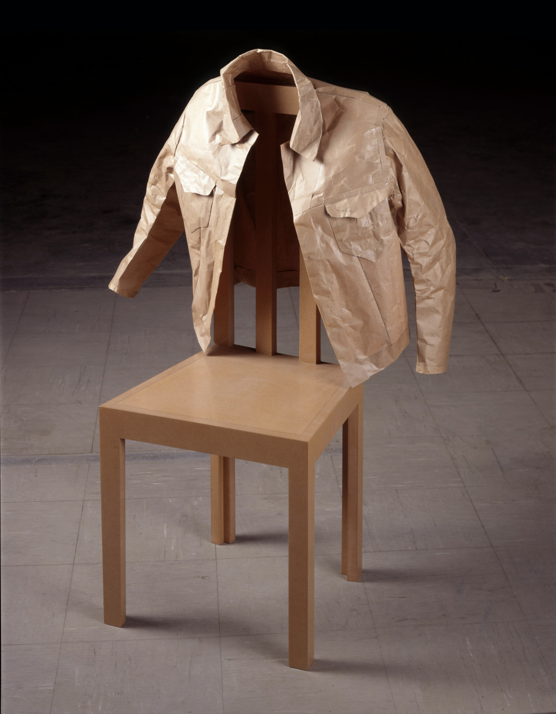 "<div class=""title""><em>Auto-erotic</em>, 1997</div><div class=""medium"">brown paper jacket, MDF chair</div><div class=""dimensions"">70 x 85 x 13 cm</div><div class=""dimensions"">27 ½ x 33 ½ x 5 in.</div>"