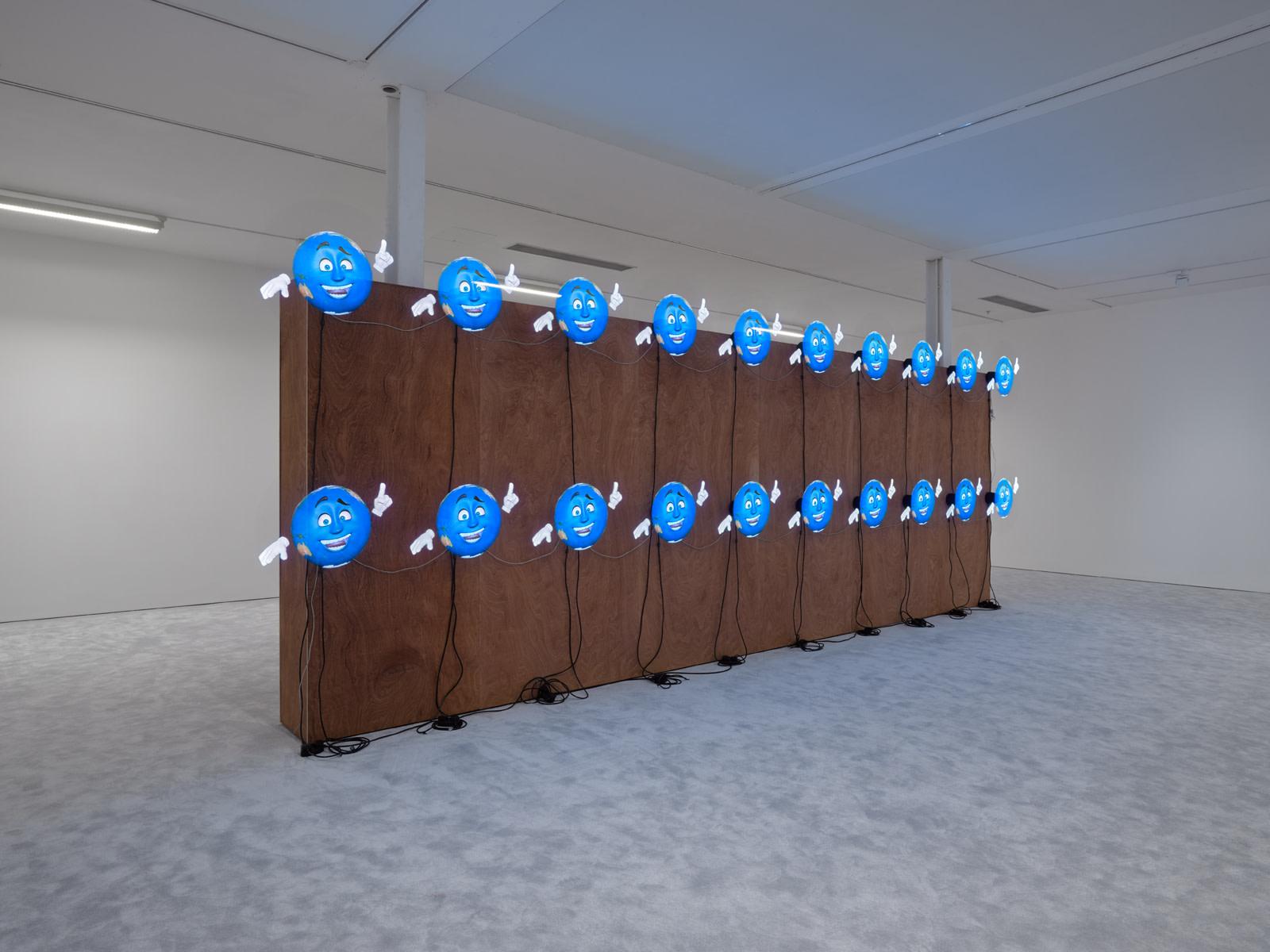"""<div class=""""artwork_caption""""><p><em>ARTISTS FRIENDS RACISTS</em>, 2020</p><p>20 3-D Holographic fans</p></div>"""