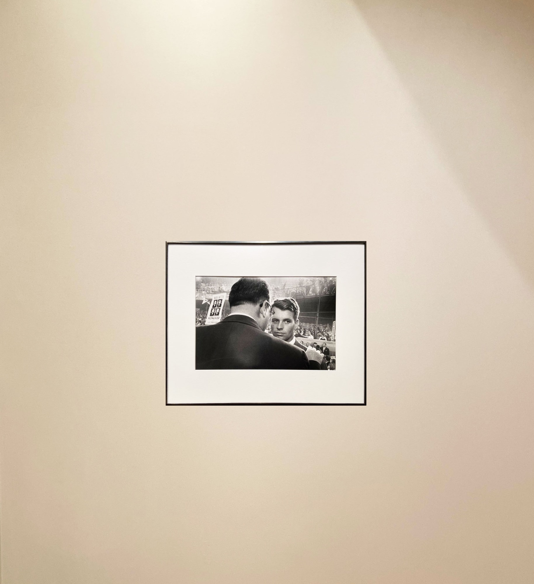 Robert Frank photograph of Robert Kennedy at a Chicago Convention, framed and hanging on a gray wall