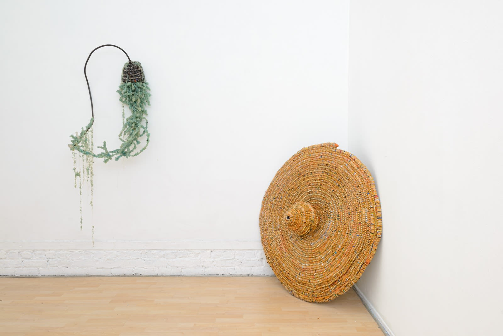 "Installation view of Lucien Shapiro's solo show ""Oculus"", featuring found-object ritual sculptures"