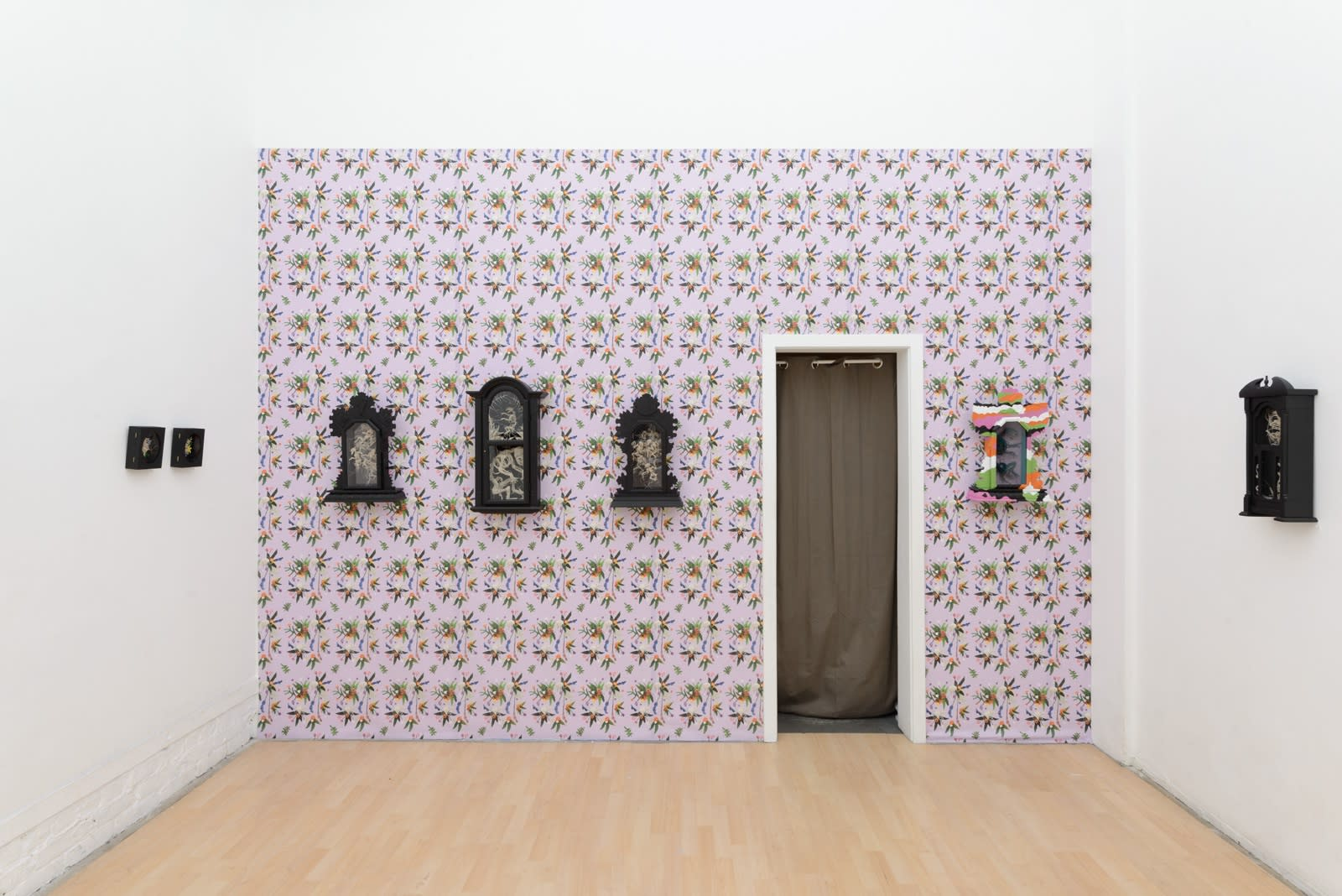 "Installation shot of Caitlin McCormack's ""GRANNY"" solo show, featuring crocheted sculptures of animal skeletons and flowers"