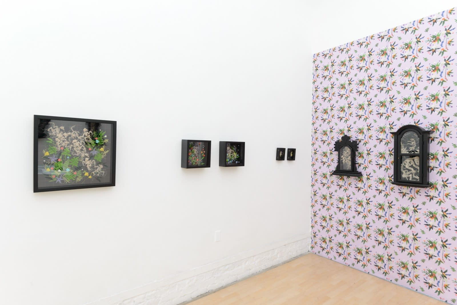 "Installation shot of Caitlin McCormack's ""GRANNY"" solo show, featuring crocheted sculptures of animal skeletons"