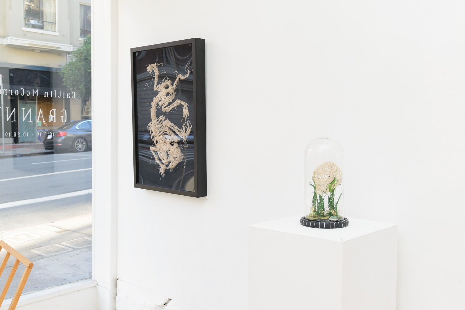 "Installation shot of Caitlin McCormack's ""GRANNY"" solo show, featuring crocheted skeletal sculptures"