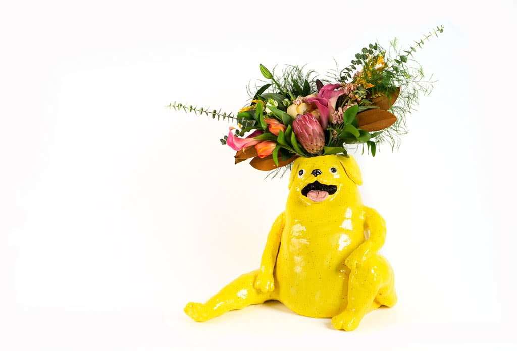 bright yellow dog vase by Katie Kimmel, full of flowers