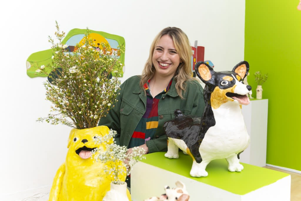 Portrait of artist Katie Kimmel with her ceramic dog vases