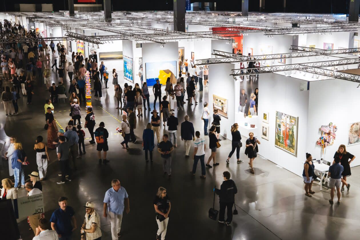 Aerial view of crowd and booth installation at Seattle Art Fair