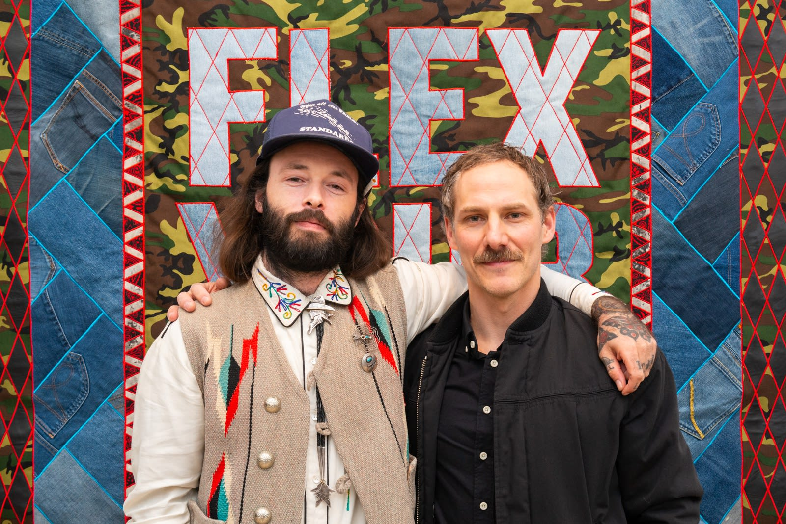 Exhibiting artists Alex Ziv and Ben Venom at the opening of Wherever I May Roam