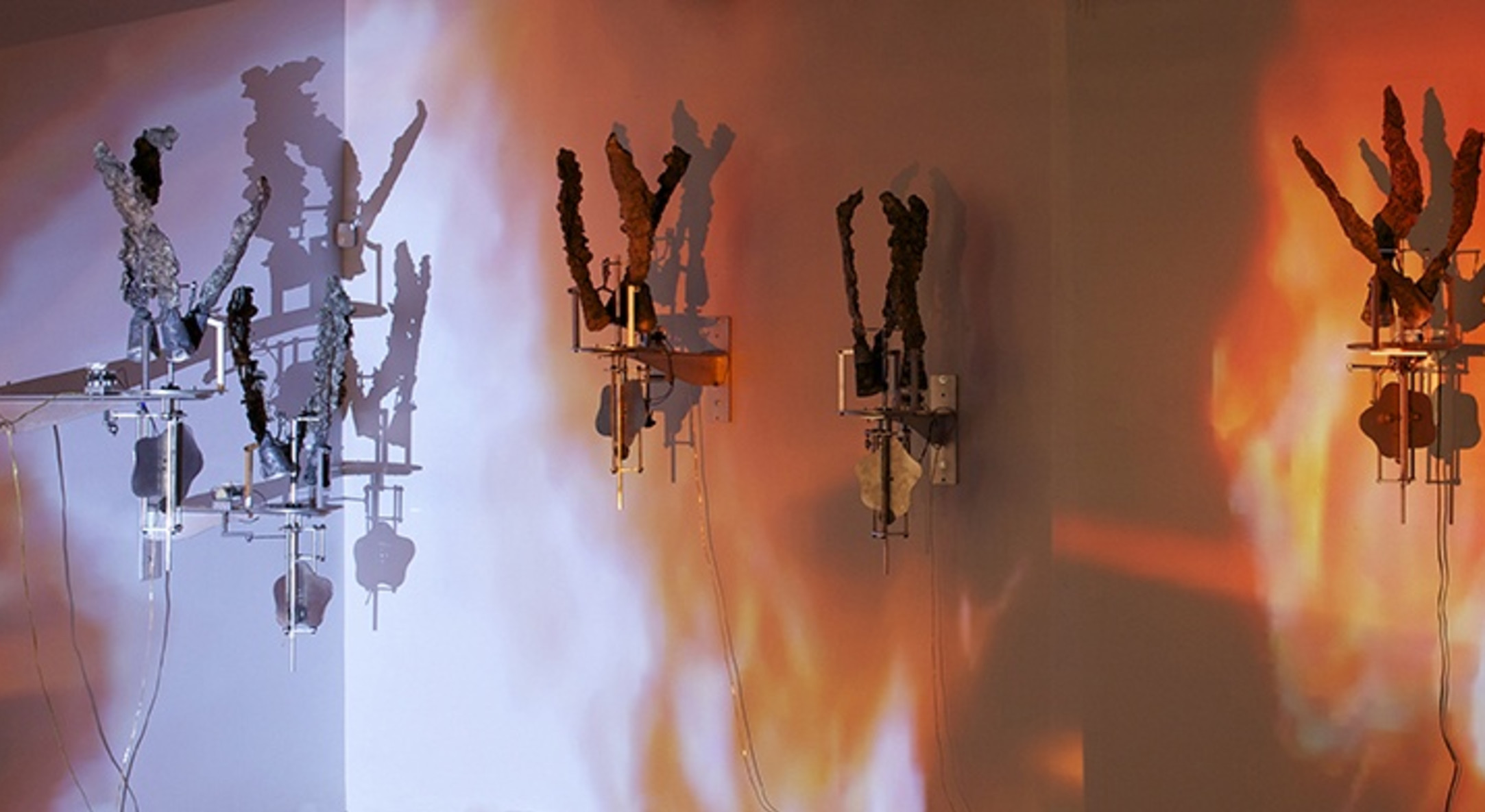 Carolee Schneemann, Flange 6rpm, 2011-2013, Foundry poured aluminum sculptures, motors 6rpm and projection, 48 x 28 x 36 in, 121.92 x 71.12 x 91.44 cm