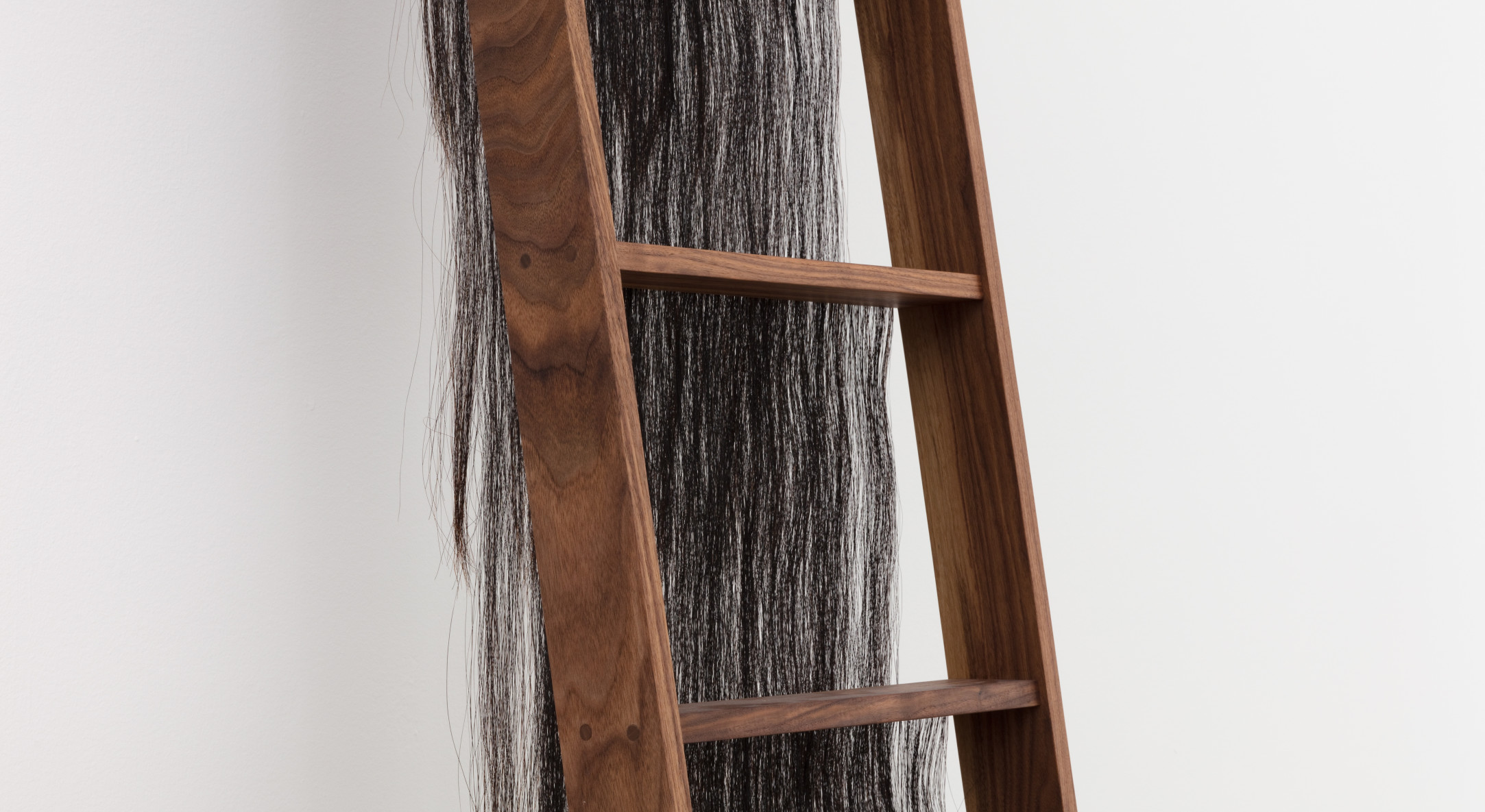 Detail of Andrea Geyer, If i told her #3, 2018, Walnut with horsehair, 315 x 44.5 cm, 124 1/8 x 17 1/2 in