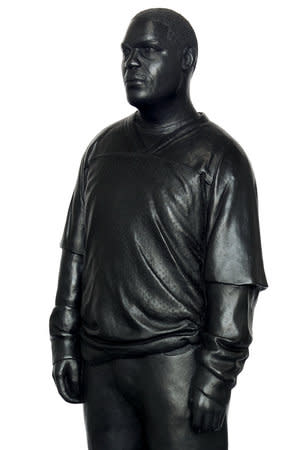 Detail of Thomas J Price, Sportswear (Achilles Street), 2011, Bronze, Perspex and wooden base, 175 x 36 cm, 68.95 x 14.18 in