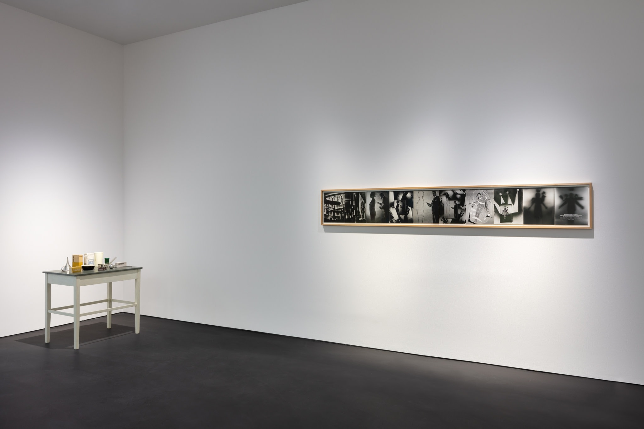 Left: Roman Ondak, Sated Table, 1997, silkscreen print on cardboard, kitchen utensils, wooden table 100 x 92 x 59 cm (39 3/8 x 36 1/4 x 23 1/4 in); right: General Idea Search for the Spirit, 1976, gelatin silver prints mounted on mat supports, 34,3 x 266,7 cm (13 1/2 x 105 in) (overall). Photo © Andrea Rossetti