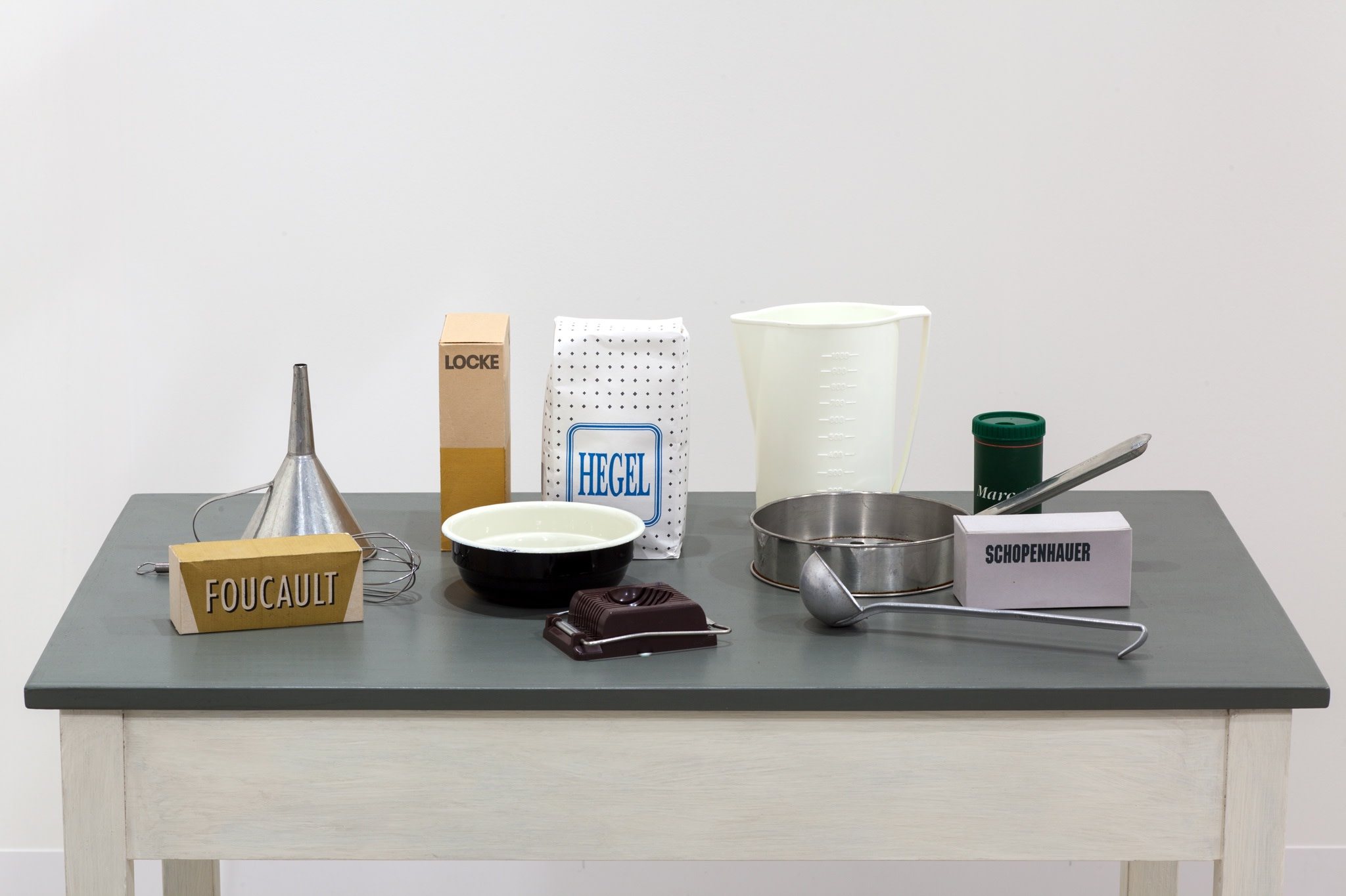 Detail: Roman Ondak, Sated Table, 1997, silkscreen print on cardboard, kitchen utensils, wooden table, 100 x 92 x 59 cm (39 3/8 x 36 1/4 x 23 1/4 in). Photo © Andrea Rossetti