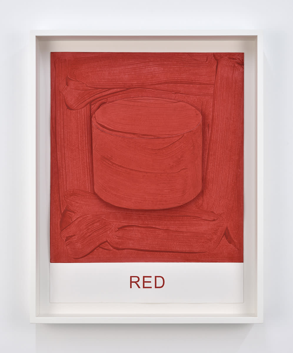 """A red cylindrical painting with the text """"RED"""" printed underneath by John Baldessari"""