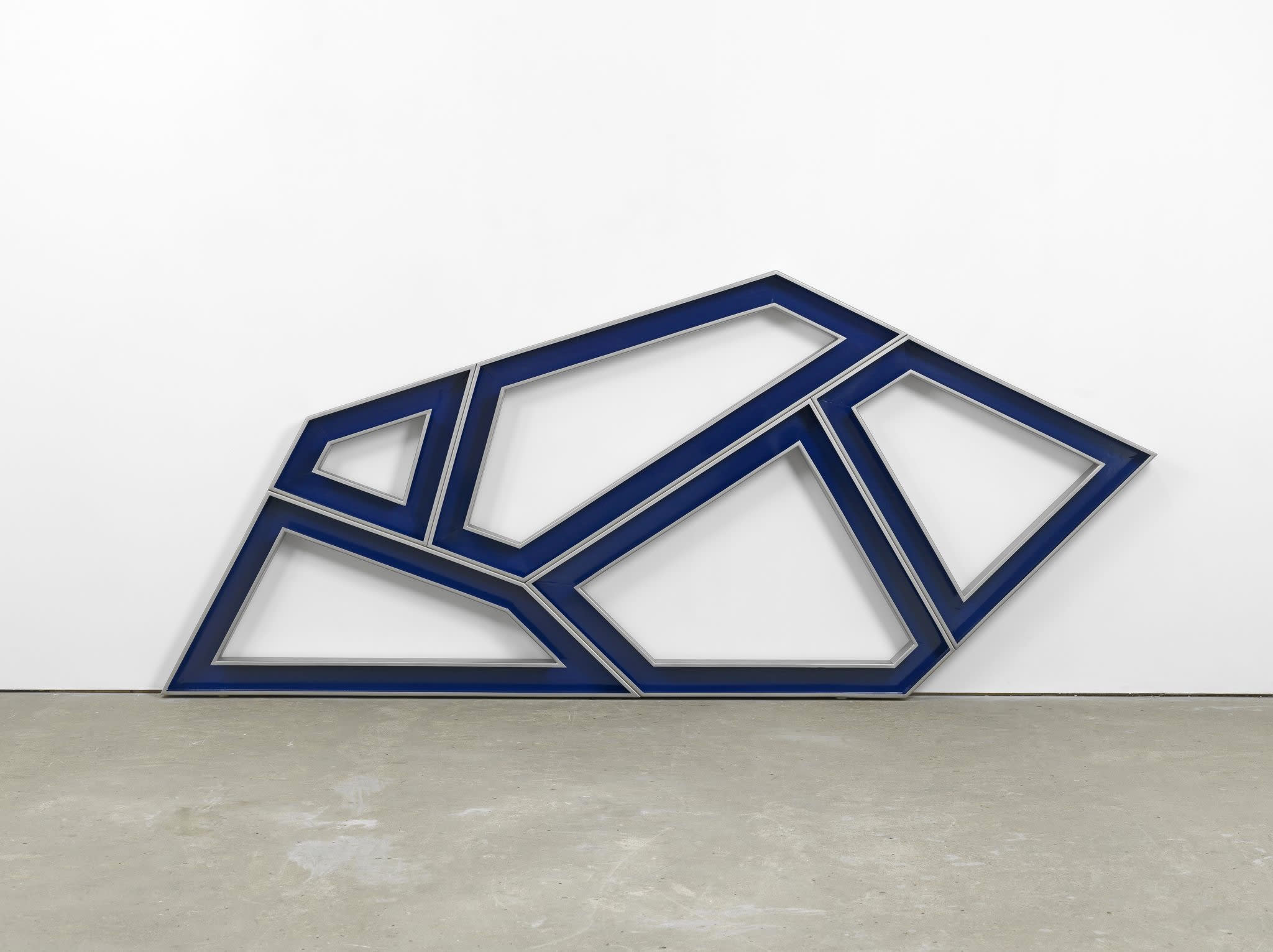 An image containing a sculpture by Richard Deacon of powder coated stainless steel