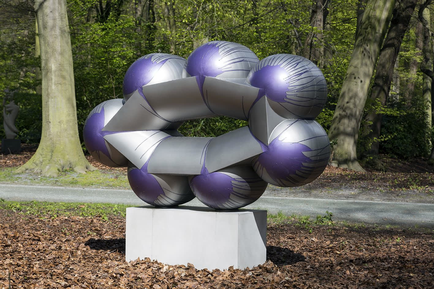 An image containing a sculpture by Richard Deacon of painted and lacquered stainless steel