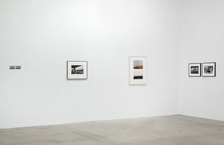 Three photographic diptychs and one photograph are displayed in the corner of a room.